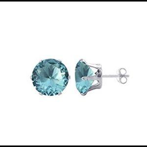 Sky blue topaz and white gold stud earrings